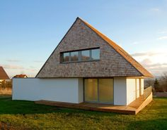 A house in Poland with an expressive triangle attic block | Inspirationist