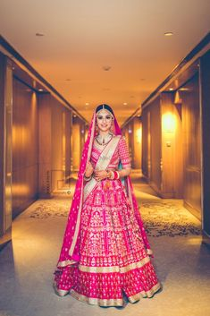 If you are bride/groom's sister, undoubtedly you have to look like a star. Definitely go for a beautiful lehenga that makes you look no less than a princess. Adorn a pink lehenga choli with some elegant jewellery. Pink Bridal Lehenga, Pink Lehenga, Indian Bridal Lehenga, Indian Bridal Outfits, Indian Bridal Wear, Indian Bride Dresses, Indian Wear, Wedding Lehenga Designs, Wedding Lehnga