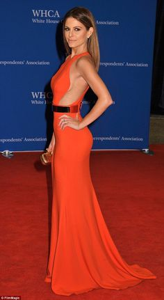 Flashing the flesh: Maria Menounos showed off some side boob in an elegant orange gown that skimmed the floor while attending the White House Correspondents' Dinner in Washington D.C. on Saturday