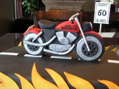 Harley Motorcycle - Cake for 60th birthday.  Motorcycle is gumpaste.  I thought about trying to do the cycle out of cake, but couldn't figure out how to get as much cake as I needed!  Thanks for looking.