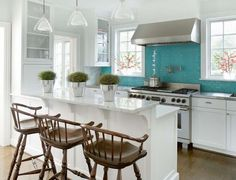 The turquoise tile backsplash combined with the white counters and those wooden bar stools (Designed by Phoebe Howard)