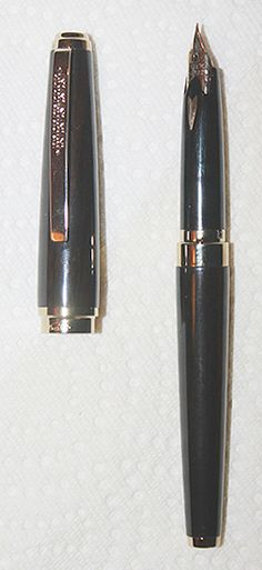 Very, VERY rare (circa 1980s) Sailor, Black Resin, Gold Trim, with Japanese text on clip.  As with Namiki and Platinum, the Fine nib is equivalent to extra fine in American and European pens--very smooth.  This pen can remain unused, with ink in it, for months at a time, and write, without skipping at first try!
