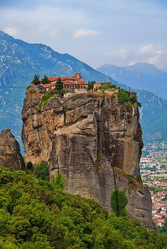 "The Monastery of the Holy Trinity, Meteora, Greece. Meaning ""suspended in air"" the name Meteora came to encompass the entire rock community of 24 monasteries. Today, only 6 monasteries survive as museums. They are sparsely occupied by a few monks and nuns Beautiful Places To Visit, Wonderful Places, Beautiful World, Great Places, Places To See, Travel Around The World, Around The Worlds, Seen, Chapelle"