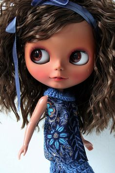 Dolls always have a little corner of my heart. I love them.. this one is particularly beautiful. I had never heard of Blythe Dolls.. until now. Amazing.