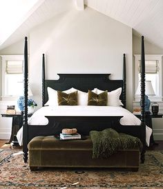 black four poster bed, cream walls, white beadboard ceiling, white wainscoting, and tufted mossy velvet pillows and bench. swoon.
