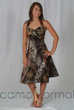 I like this one too for my wedding party...but again instead of all camo my bridesmaids dresses will be orange with a camo waist sash and my maid of honor's dress will be brown with an orange or camo waist sash. All with a camo laceup back