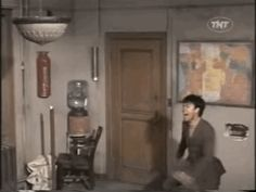 When a light on the ceiling goes out and you can't find a tall-enough ladder to reach it: | 24 Badass Bruce Lee GIFS For Absolutely Every Situation