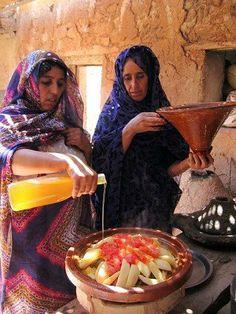 Moroccan Women preparing a Tagine