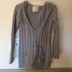 """Knit hooded sweater Heather grey hooded cable knit sweater with front hand pouch. 27"""" from shoulder to bottom. Aeropostale Sweaters Crew & Scoop Necks"""