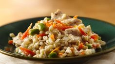 """""""Time-consuming"""" come to mind when you hear """"risotto?"""" Not with this simple slow cooker recipe of chicken breasts, barley and green soybeans. Make it your way with the easy variation below."""
