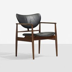 Finn Juhl armchair, model NV-48 Niels Vodder Denmark, 1948 stained teak, leather 27 w x 25 d x 32 h inches Signed with branded manufacturer's mark to frame: [Niels Vodder Cabinetmaker Copenhagen Denmark Design Finn Juhl].
