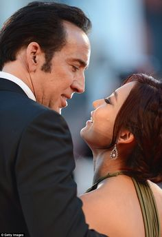 Loved up: Nicolas Cage only had eyes for his wife Alice Kim at the premiere of Joe at Venice Film Festival