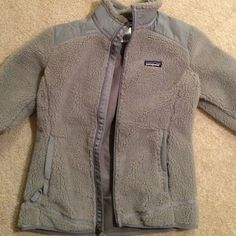 Brand New Patagonia Grey Fleece Lined Jacket beautiful Patagonia Fleece Jacket. This jacket is brand new, has been worn once. Very warm. Size Medium but fits like a bigger small. I love this jacket but it too snug on me :(. Price is negotiable, however I paid full price for this item. Patagonia Jackets & Coats
