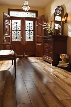 Some people are afraid to clash hardwood with doors and furniture, but this entryway shows how it can be done.