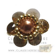 Cristales Swarovski® Elements Xilion RivoliTopaz de 6mm, perla checa color copper nº 6, mostacillas calibradas color oro y anilla...