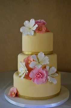 Wedding cake with Tropical Fondant Flowers. Beige cake with flowers to match girls' bouquet