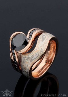Custom Engagement Ring and Contoured Mokume Wedding Band in rose gold! The Carved Wave Engagement Ring has two channels of black diamonds that run up the band and flow towards the black diamond center stone. The Contoured Mokume Wedding Band was done in our Champagne Mome Gane. Choose your metal, mokume and stones and we will create your dream bridal set!