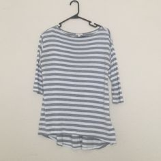 Striped Shirt 3/4 sleeve. two very small holes in the front bottom of the shirt (shown in photo -- and i have no idea where that came from). GAP Tops Tees - Long Sleeve