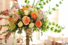 Occasions by Shangri-La, a full service event decor and floral company based out of Orlando, creates gorgeous centerpieces for receptions & weddings.