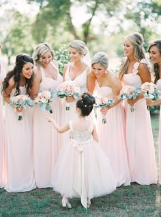 Photography : Tracy Enoch | Wedding Dress : Maggie Sottero | Bridesmaids Dresses : Bill Levkoff | Floral Design : Central Market Read More on SMP: http://www.stylemepretty.com/texas-weddings/2016/04/14/a-gorgeous-blush-texas-wedding-on-a-tight-budget/