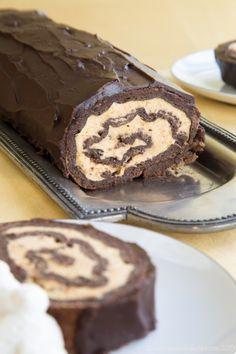 Pumpkin Cheesecake Flourless Chocolate Cake Roll - an impressive dessert for fall with pumpkin cheesecake mousse, chocolate sponge cake, and rich chocolate ganache.
