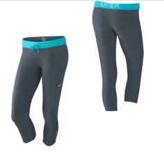 """Nike Dri Fit Capris Nike dri fit capris. Grey with baby blue coloring. When you fold the band down, the back says """"Just Do It"""". Posted a picture from the website to give you a better idea of the color. Since my flash on my phone makes it darker. Nike Pants Capris"""