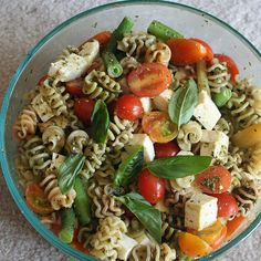 Healthy work lunch - spiralli pesto pasta with basil, feta and tomatoes