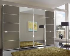 Wiemann VIP Westside 4 Door Mirror Sliding Wardrobe in Havana Glass - W - available to buy online or at Choice Furniture Superstore UK on stockist sale price. Get volume - discount with fast and Free Delivery. 3 Door Sliding Wardrobe, Sliding Doors, Hanging Rail, Furniture Assembly, Ceiling Height, Mirror Door, Adjustable Shelving, Wardrobes, Havana