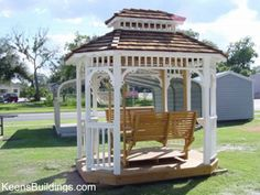 Wood gazebo complete with swing bench seats -- ready for great conversations.