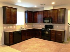 Kitchen Cabinets Black Appliances i like this look a lot! black appliances, cherry cabinets, and