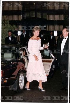Princess Diana glitters in a pearl and diamante encrusted petal pink gown with full pleated skirt by Catherine Walker as she unveils the plaque at the re-opening of the Savoy Theatre on Monday, 19 July 1993.