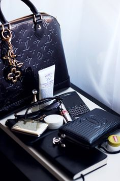 Louis Vuitton Purse, Kiehls Ultimate Hand Cream, J'adore Dior Perfume, Prada Sunglasses, Michael Kors Sunglasses Pouch, Dior Creme De Rose Lip Balm, Guerlain Powder, Leather Journal, YSL Rouge Volupte Lipstick, Blackberry Cell Phone, , Chanel Wallet, Hair Tie, Carmex Cherry Lip Balm.