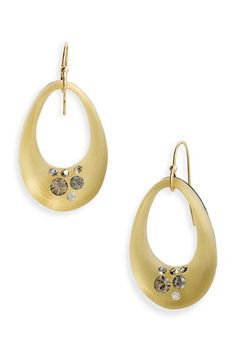I am always wearing my Alexis Bittar earrings (especially the lucite ones)  because they don't get lost against the darkness of my hair. These are super cool.