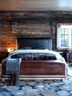 Love the natural materials in this lovely log home bedroom!