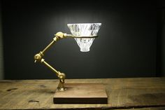 """Crafted from brass, """"The Curator"""" utilizes the Hario V60 glass pour over (included) resting on the ring that adjusts to the height of your mug or decanter. The"""