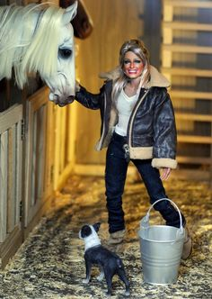 https://flic.kr/p/Fmsusu   dinner bell   It's supper time in the barn!  Farrah and Patches rustle up the grub for the horses.  Black Label Barbie of Farrah Fawcett as restyled and repainted by Noel Cruz of www.ncruz.com for www.myfarrah.com in a Regent Miniatures diorama, Regent Horse-Barn by Ken Haseltine (www.regentminiatures.com).   Visit: www.myfarrah.com.  Farrah is on facebook www.facebook.com/FLFawcett  On Tumblr at; farrahlenifawcett.tumblr.com  On ipernity at…