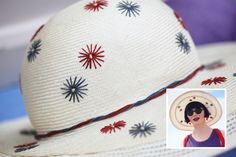 This hat was donated to the ABC and the costume team reworked and restored it by re-embroidering the flowers and replacing the raffia. They also extended the brim to make it a summer hat for Phryne's beach holiday.