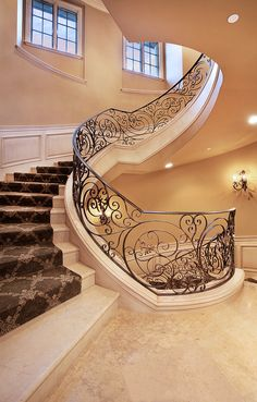 If I were rich enough to own a house like this, I could pay someone to walk up and down all those stairs for me.