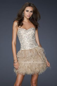 This cocktail dress is a one-of-a-kind strapless gown with a sweetheart neckline. Feathers from the waist down to the bottom hem