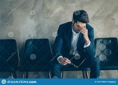 Portrait of sad upset frustrated businessman sit on chair touch nose, fingers have headache about his work mistake wait for boss argue wear blue blazer pants isolated grey color background Economics, Appointments, Fingers, Fails, Art Ideas, Boss, Sad, Touch, Blazer