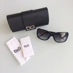 Dolce and Gabbana sunnies Authentic black Dolce and Gabbana sunglasses with silver DG on sides. Includes original case and cloth. Like-new condition. Dolce & Gabbana Accessories Sunglasses