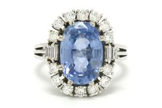 The San Francisco 7 carat Ceylon sapphire engagement ring is centered by a dreamy, velvety, cornflower blue sapphire certified as no heat by the American Gemological Laboratory. Yes, this vintage estate heirloom it has a pedigree and is destined for a new home. Surrounded by a captivating diamond halo of round and baguette cuts, set simply in a sumptuous white gold mounting. #ceylonsapphire #artdeco #engagementring #love #ido #ceylonsapphires #bluesapphire #diamond #engagementrings Estate Engagement Ring, Gemstone Engagement Rings, Antique Engagement Rings, Ceylon Sapphire, Sapphire Diamond, Halo Diamond, Blue Sapphire, White Gold, Gemstones