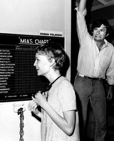 A behind the scenes photo of Rosemary's Baby (1968) with actress Mia Farrow and director Roman Polanski. ☚