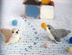 this book is a collection of little needle-felted animals in the cutest settings.    there are 21 projects, each with an adorable animal with its own scene, complete with tiny felted accessories. many of these are little shops, and the project directio