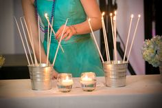 Instead of putting all the candles on the cake to have wax drip on we put the candles in a bucket. It was a beached themed Bat-Mitzvah! It was beautiful.