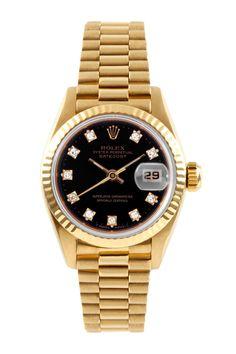Love this black & gold Vintage Rolex.