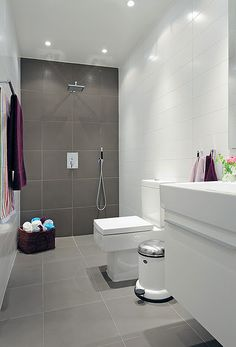 Bathroom, with different sized wall tiles, grey and white