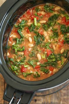 Slow Cooker Tomato, Kale and Quinoa Soup - Comforting, nourishing and healthy made in the crockpot. Even the quinoa gets cooked right in! 214.2 cal