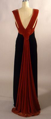 """Evening Dress, Madeleine Vionnet: ca. 1933, bias-cut rayon jersey, silk crepe sash. """"The dress was made of rayon jersey, treated in bias cut to fit around the body. The surrounding sash has the effect of highlighting the sleek body. The dress is from Madeleine Vionnet's personal wardrobe. Back"""