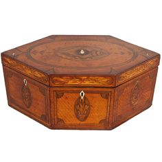 18th Century Inlaid tea Caddie-A George III Period Hexagonal Satinwood and Marquetry Inlaid Tea Caddy having oval Prince of Wales feather decoration and multiple lines of string inlay and crossbanding.  1stdibs/Rumi